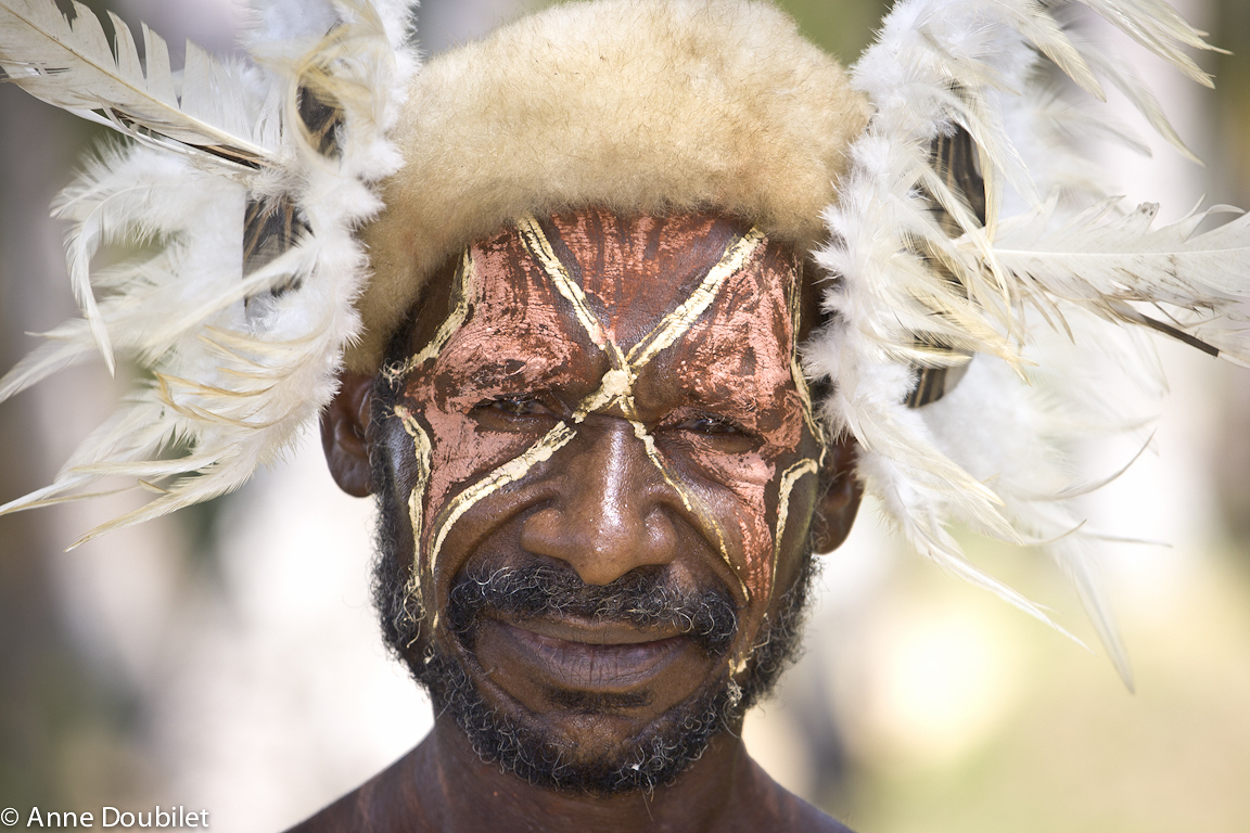 Tribesman in white feathers and cusscuss fur, Konmei River, Papua New Guinea.